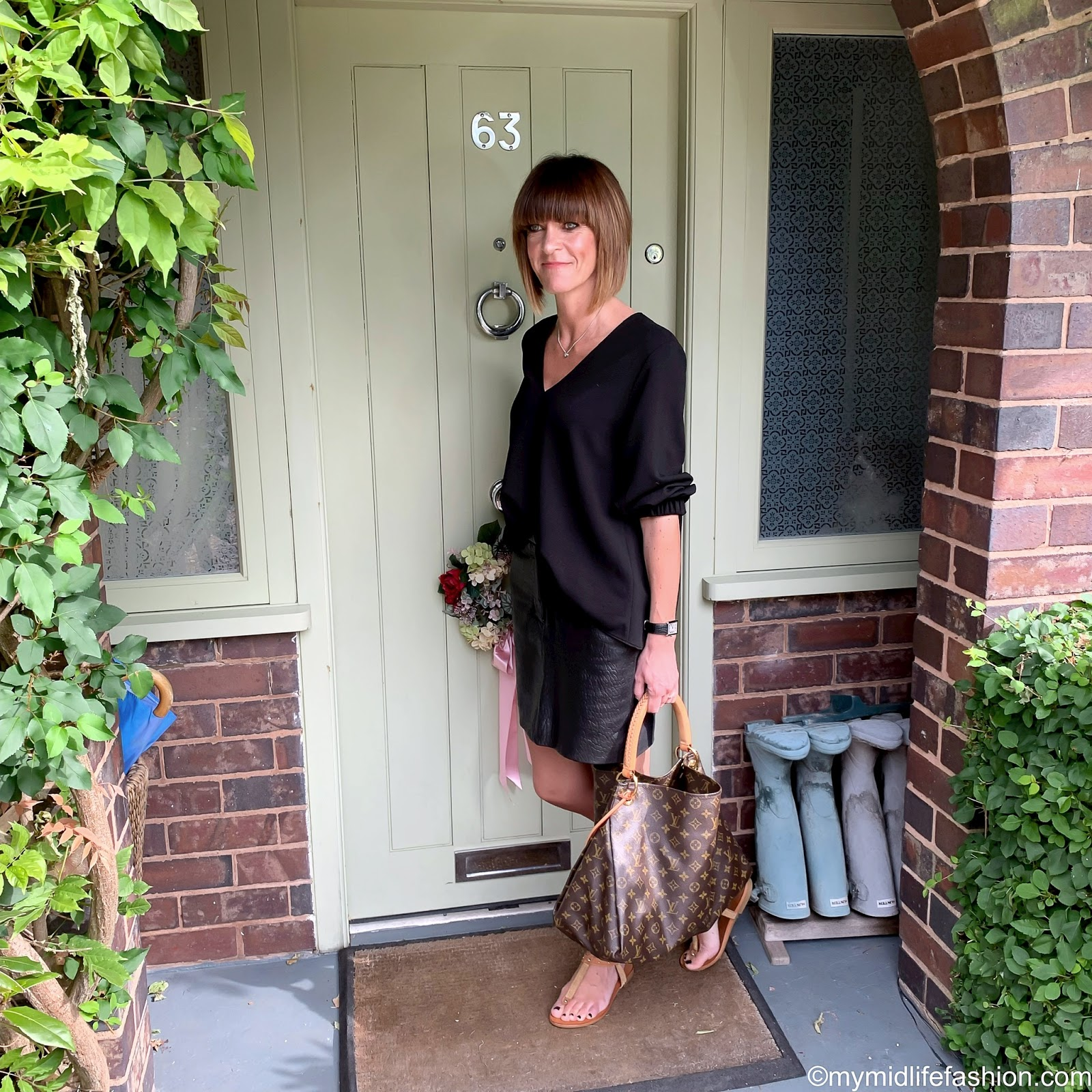 my midlife fashion, tibi v neck loose fit blouse, marks and Spencer leather textured mini skirt, Louis Vuitton bag, carvel Koncert sandals
