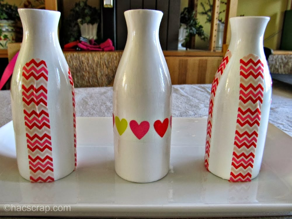 Use Washi Tape and Milk Bottles for and easy Valentine's Day Centerpiece - just add candy hearts