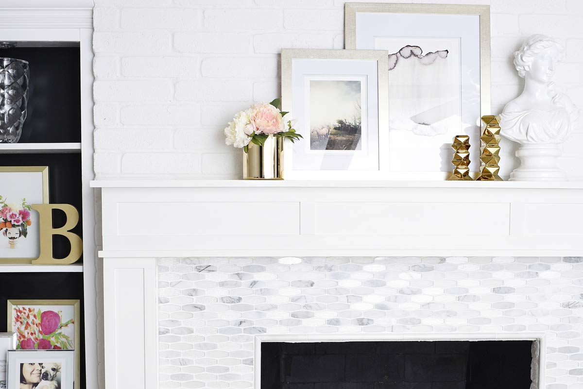 Marble fireplace with custom built surround and mantle. | via monicawantsit.com
