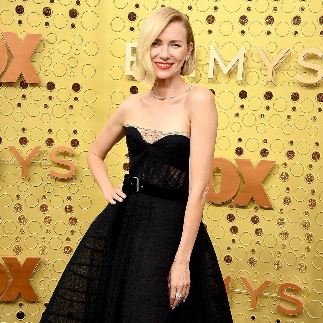 Naomi Watts displays her toned arms in a strapless black Dior gown at the Emmy Awards