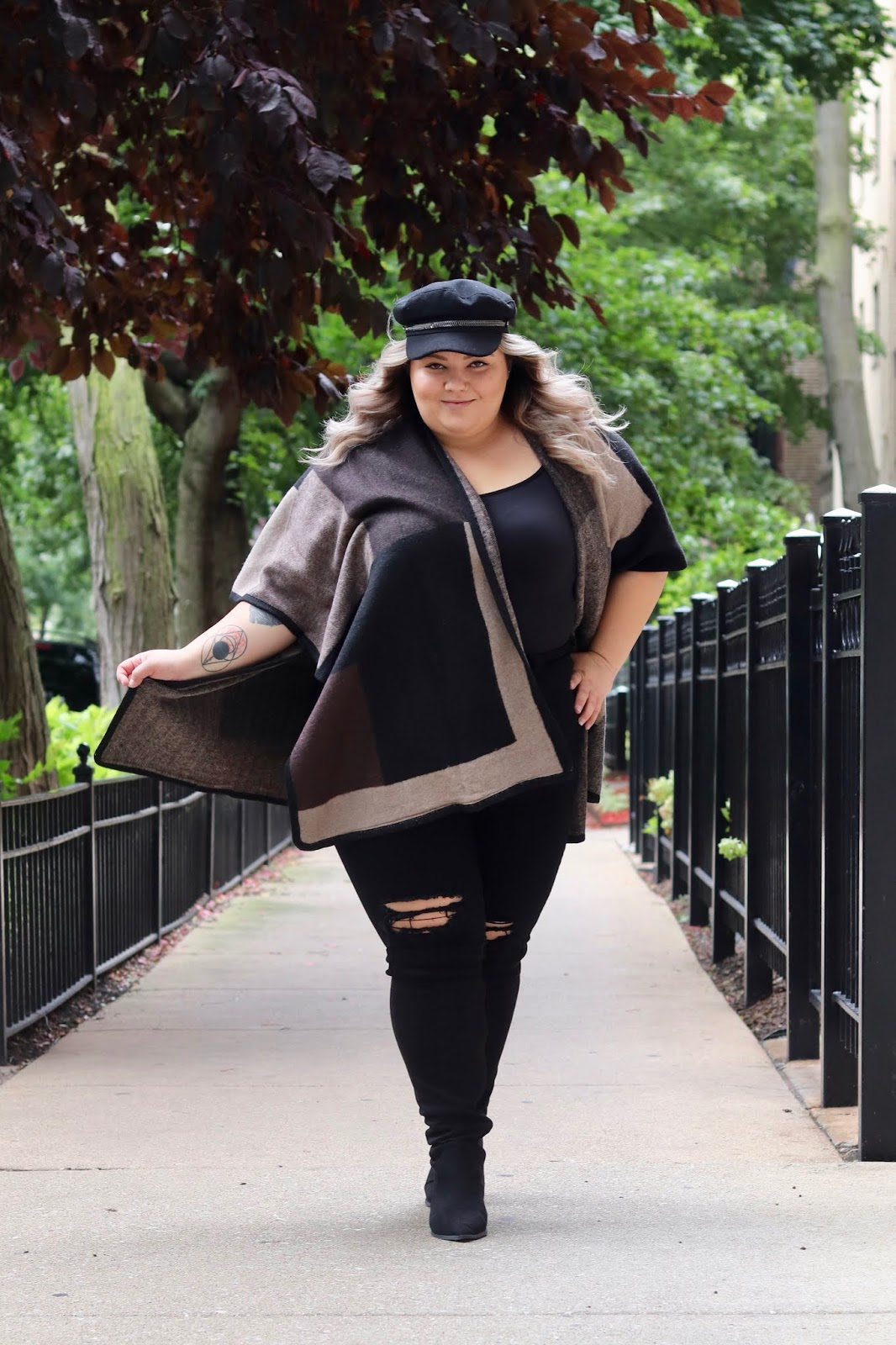 Chicago Plus Size Petite Fashion Blogger, influencer, YouTuber, and model Natalie Craig, of Natalie in the City, rocks sweaters and fall fashion from Gordmans, an off-price retailer.
