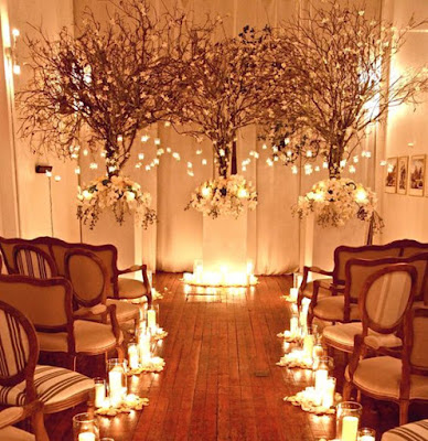 white flowers and potted trees and plant wedding venue decor