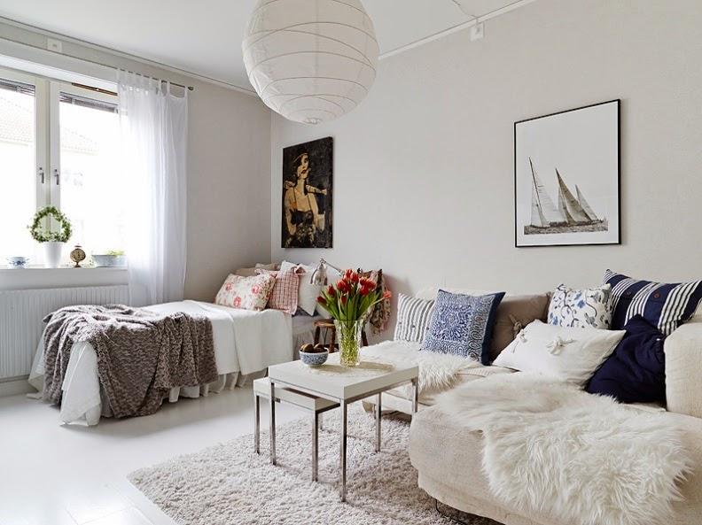 dormitorio y salón en un mismo espacio