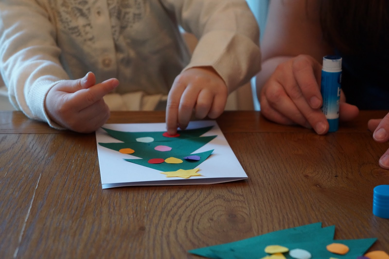 preschooler sticking dots on a paper