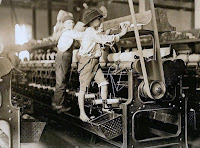 Children Working on Handloom, a photograph by Lewis Hine.
