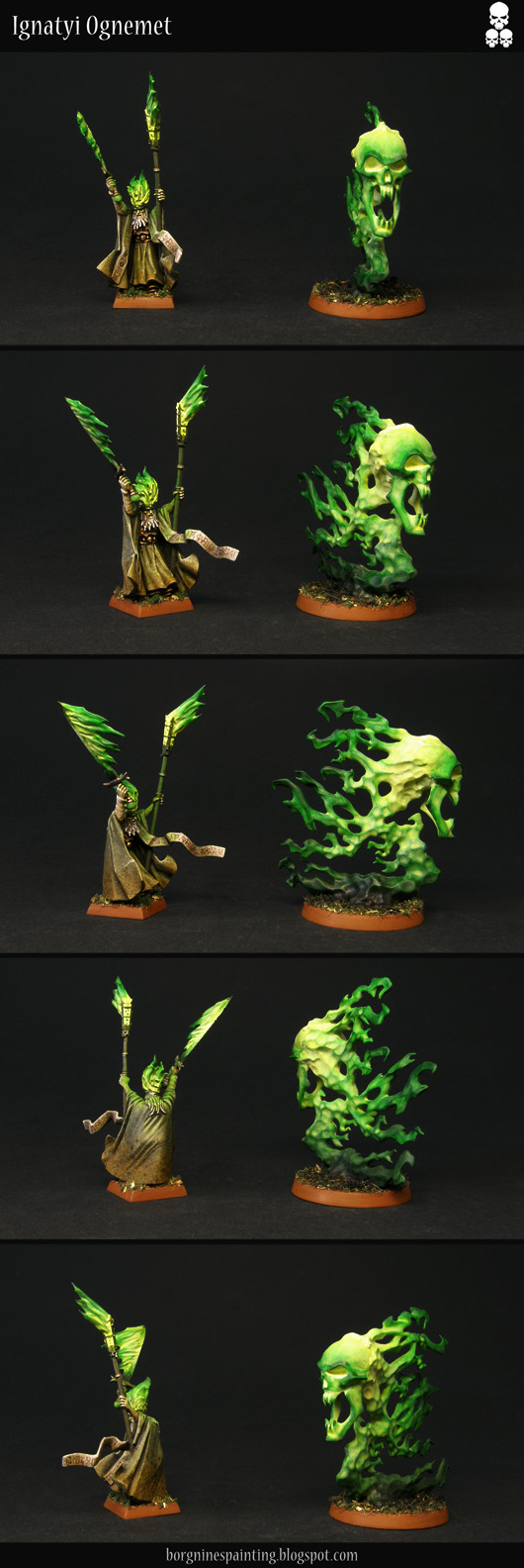 Two painted models - one, a converted fire necromancer lifting a flaming staff and a burning sword up high, with a Burning Head endless spell next to him. The flames on both are painted green with OSL effects on the wizard. The miniature is visible from several angles.