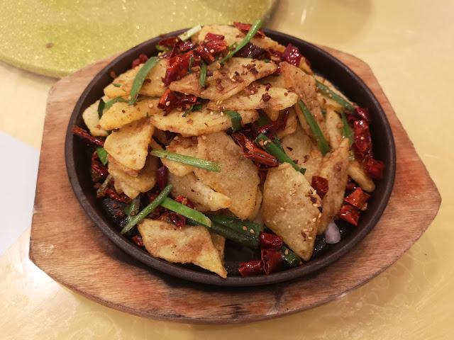 Potato Slices on Iron Hot Plate