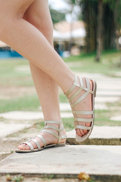 Fashion and Travel Blogger GlobalFashionGal (Brianna Degaston) wearing gold sandals at a resort in Bintan Island, Indonesia.