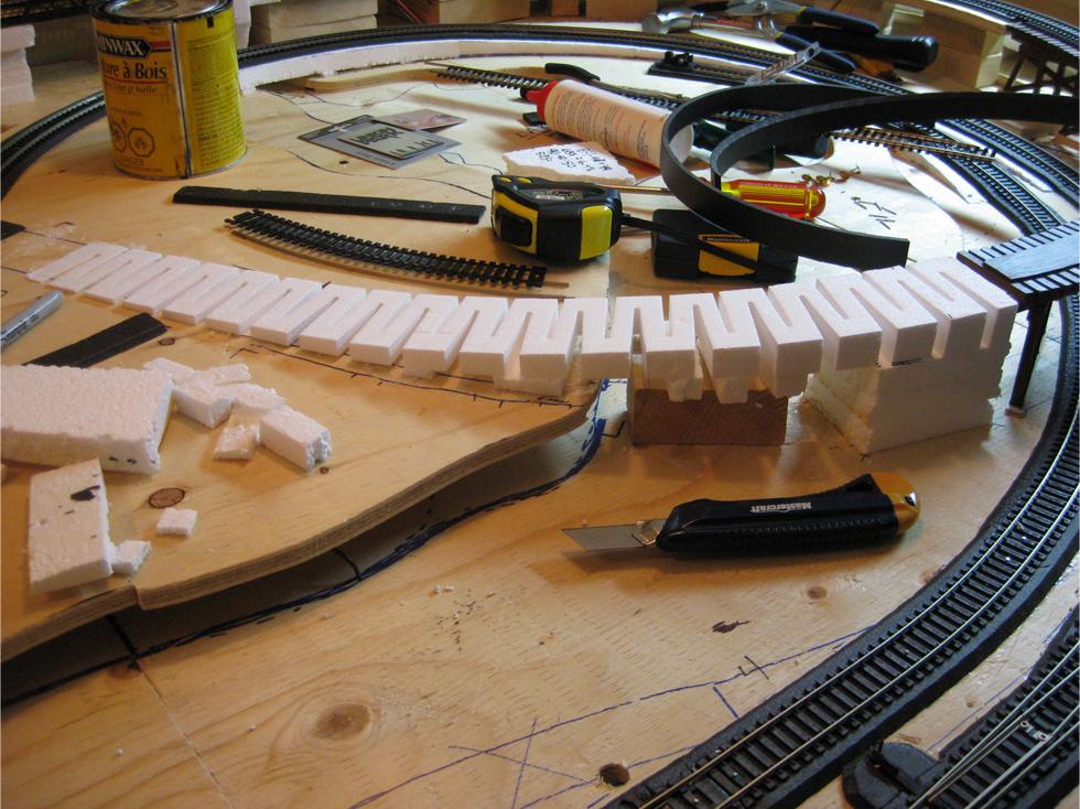 Foam risers from Woodland Scenics replacing custom foam risers leading down from wood train trestle