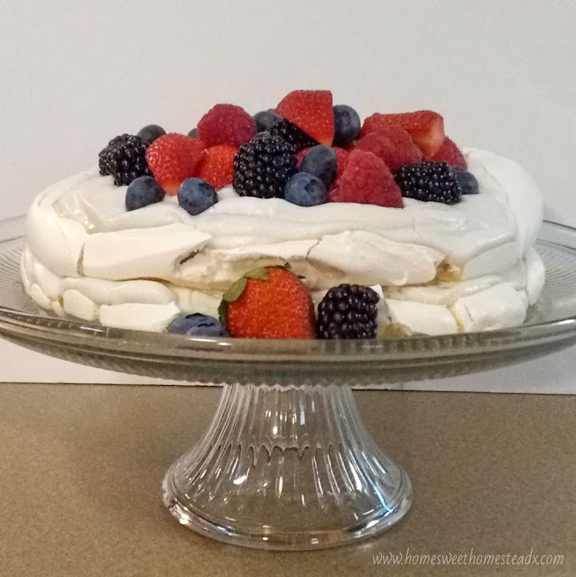 Summer Berries Pavlova Cake: Home Sweet Homestead #SummerDessertWeek Crispy on the outside, marshmallow-y soft on the inside meringue, coconut whipped cream, and fresh summer berries come together to make a deliciously beautiful dessert, that couldn't be easier to make!