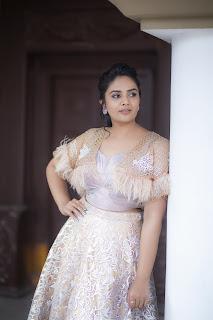 Sree Mukhi latest photos in white rose golden dress Navel Queens