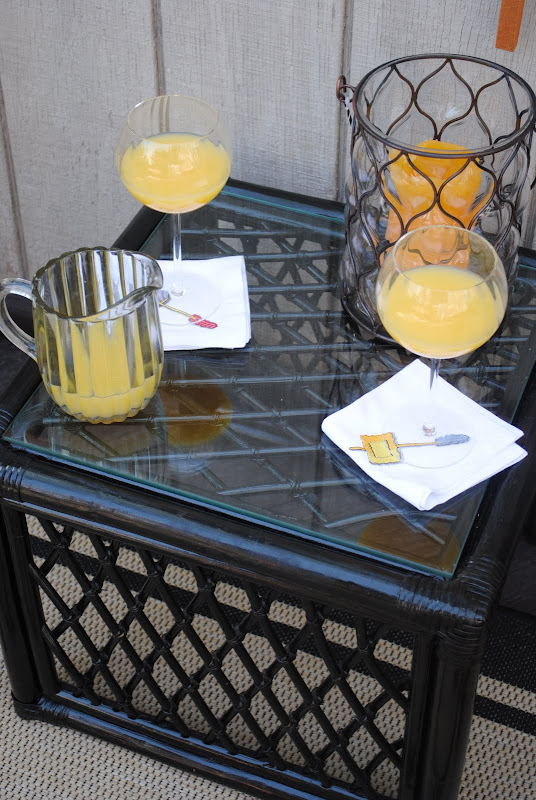 Side table with drinks and a candle