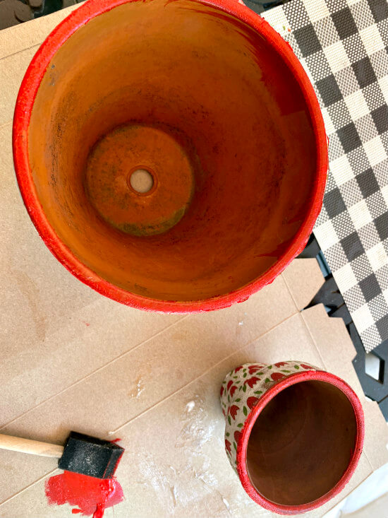 Painting a red rim on the flower pot