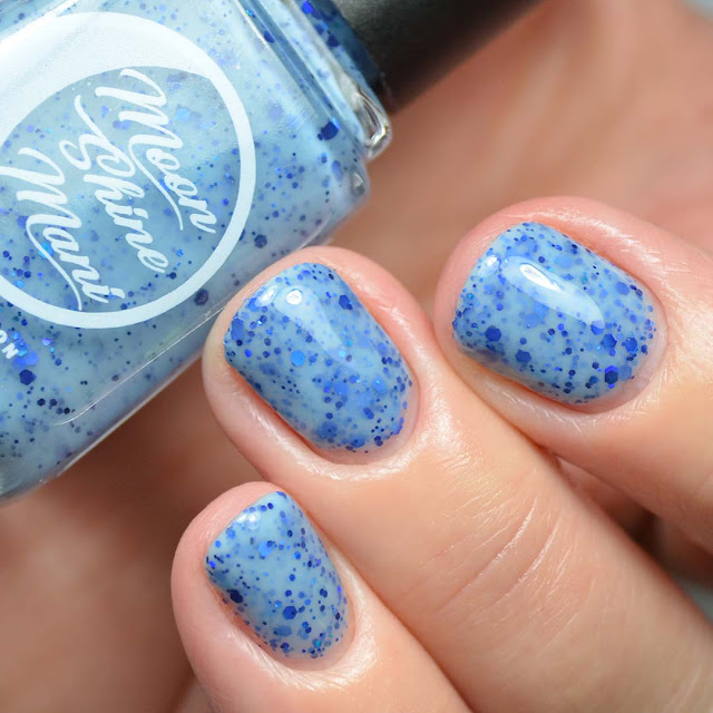light blue nail polish with blue glitter swatch