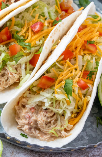 This easy crock pot taco recipe is unique, flavorful, uses pantry and fridge ingredients and is such an inexpensive meal. Use this slow cooked creamy shredded chicken for burritos, tacos, tostadas, taco salad, enchiladas, taquitos and more!