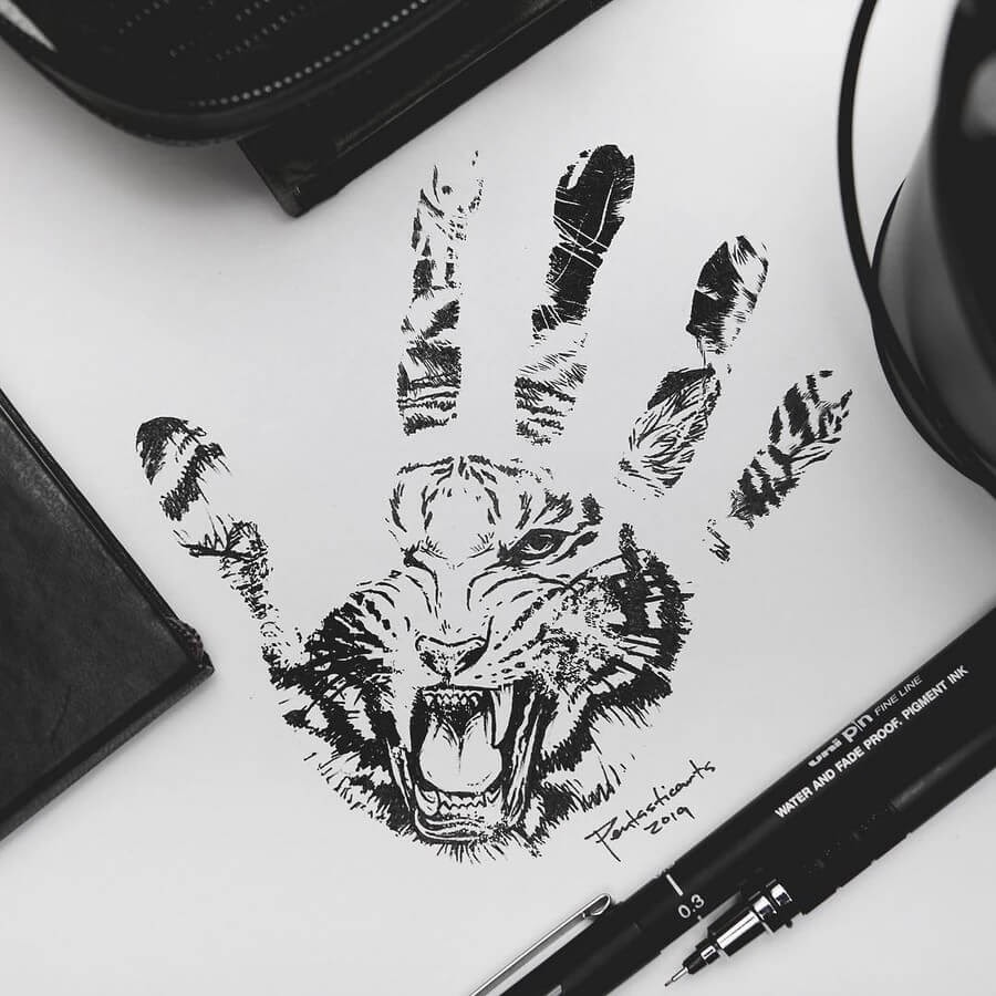 02-Tiger-Hand-Joseph-Catimbang-Ink-Drawings-in-Various-Styles-www-designstack-co
