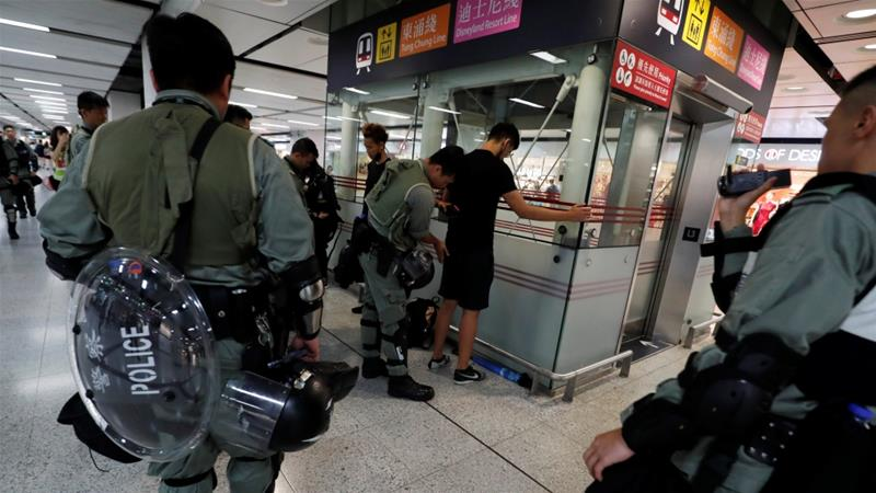 Police were conducting frequent searches at the airport hours before protests were expected to start