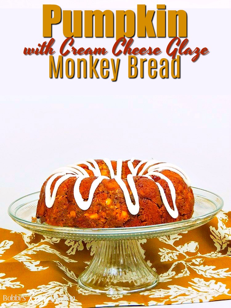 This Pumpkin Monkey Bread recipe is easy to make, full of delicious pumpkin flavor, and topped with a decadent cream cheese glaze. #pumpkin #bread #cake #monkey #easy #recipe #cheese | bobbiskozykitchen.com