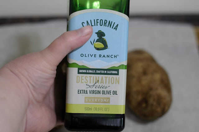 A bottle of oil used to drizzle over the potatoes.
