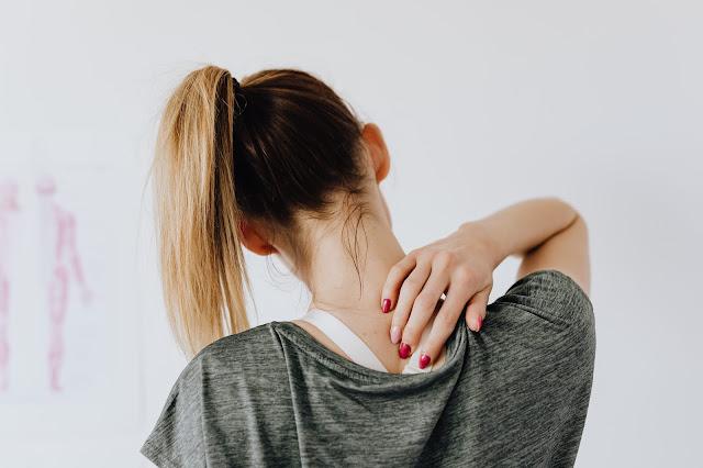 women experiencing neck pain