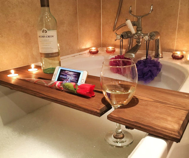 Ensure you're as comfortable as possible during your next soak by placing all your bathtime essentials on this relaxation wooden bathtub caddy. Each handmade caddy has a wine glass holder, two recessed holes for tea lights, and a slot large enough for your tablet.