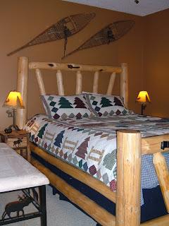 Interor bedroom with a log bed.