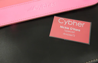 Cybher speaker badge and pink leather branded satchel