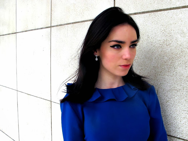 Fashion blogger Emma Louise Layla wearing sterling silver Bouton drop earrings