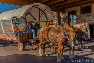 Cramer Imaging's photograph of two horses attached to a covered wagon for tourist rides in Bryce City Utah