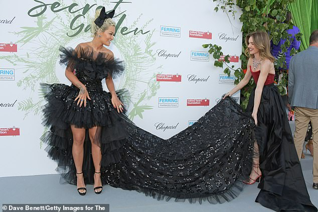 Rita Ora receives help from supermodel Natalia Vodianova at the Naked Heart Foundation