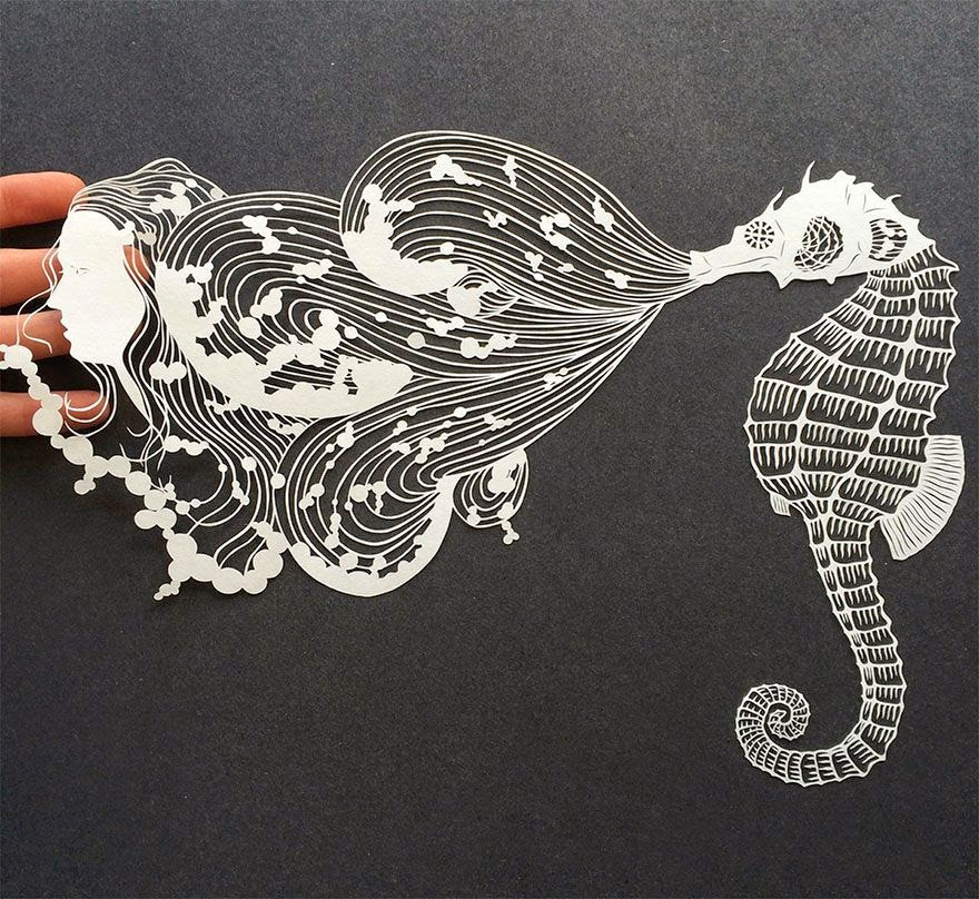 Incredibly intricate hand-cut paper art