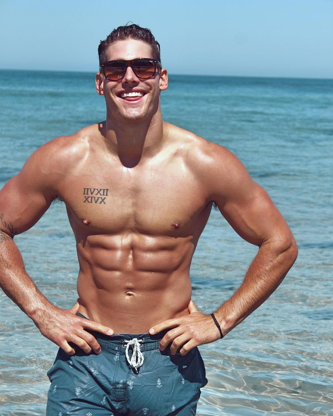 fit-sun-tanned-shirtless-body-sixpack-abs-cute-guy-smiling-sunglasses-sea