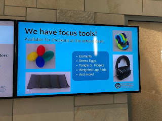 Screen with images of focus tools including stress eggs, weighted lap pads, tangle fidgets, and noise-canceling headphones