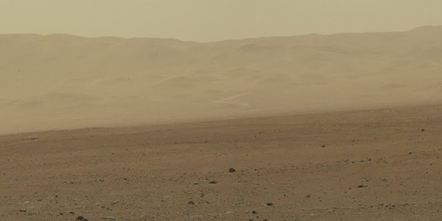 In this handout image provided by NASA/JPL-Caltech/MSSS, a color image from NASA's Curiosity rover's Mast Camera shows part of the wall of Gale Crater, the location on Mars where the rover landed August 5, 2012 on Mars. NASA