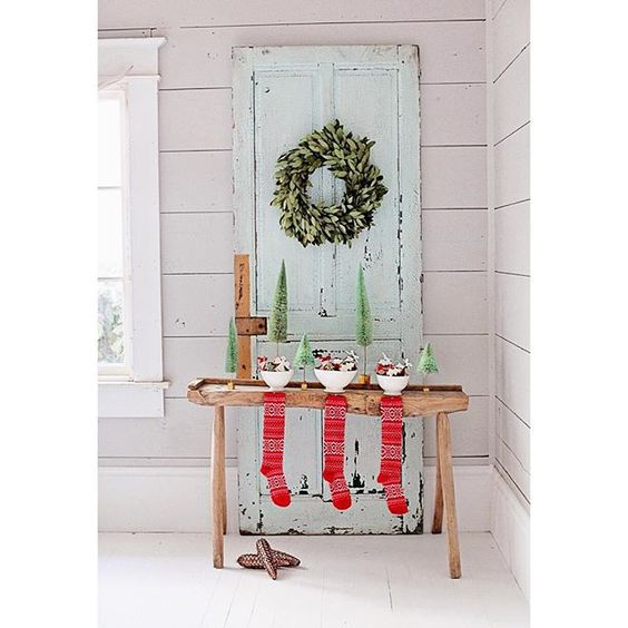 Vintage stockings and weathered door romantic Farmhouse Christmas holiday decorating shabby chic