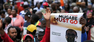 Thousands celebrate end of Mugabe era