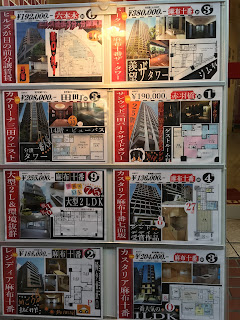 An ad outside a real estate agency for eight different apartments in Azabu Juban, central Tokyo