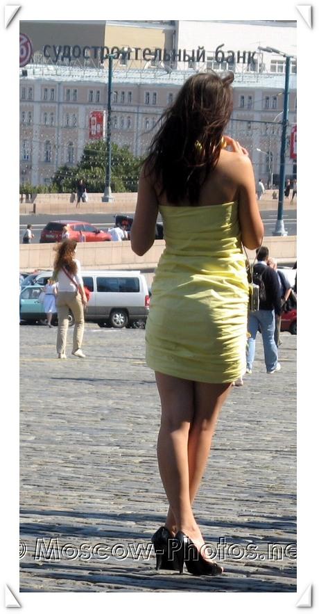 Slim brunette girl in summer dress