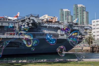 Bubbles in front of USS Midway