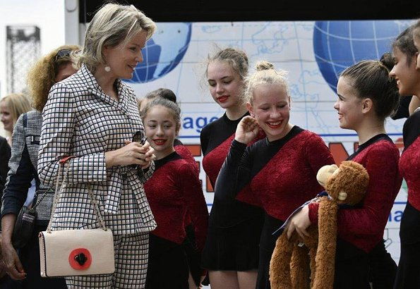 Queen Mathilde visited the Eurogym 2018 International Gymnastics FestivalShe wore Natan pantsuit Natan Collection, Armani clutch