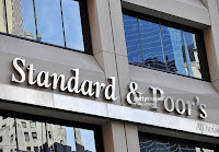 Standard & Poor's headquarters in the financial district of New York on August 6, 2011. The United States' credit rating was cut for the first time ever August 5 when Standard and Poor's lowered it from triple-A to AA+, citing the country's looming deficit burden and weak policy-making process. (Credit: AFP Photo/Stan Honda) Click to Enlarge.