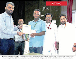 CITY PIC: Mandip Singh Brar, Returning Officer-cum-Deputy Commissioner, Chandigarh presenting Certificate of Election to the General Lok Sabha from Chandigarh Parliamentary Constituency to Dheeraj Jain, Election Agent of Kirron Kher, the wining candidate at CCET Sector 26, Chandigarh