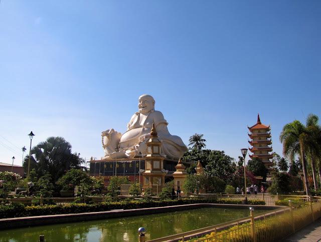 laughing buddha vinh trang pagoda mekong delta vietnam