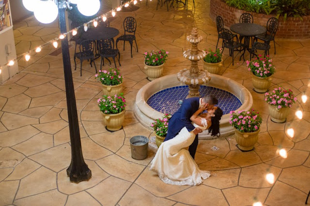 bride and groom kissing after reception