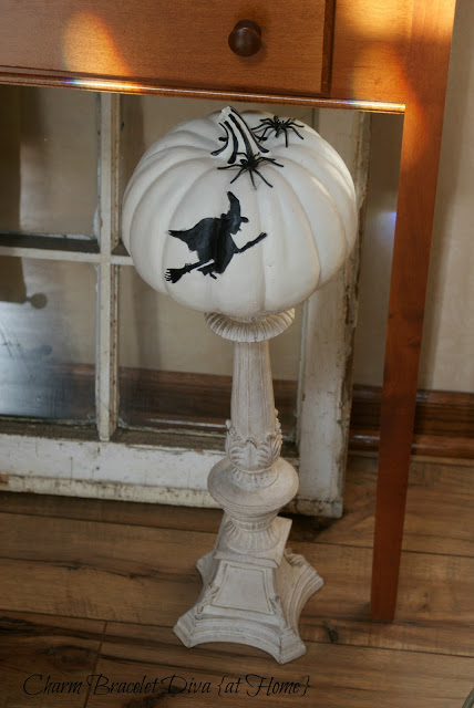 white faux pumpkin witch silhouette ornate tall vintage candlestick