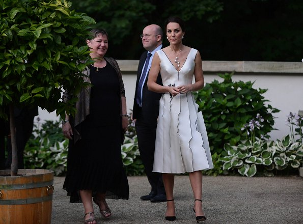 Kate Middleton wore Gosia Baczynska dress and Balenciaga earrings. Kate Middleton carried PRADA Satin Clutch