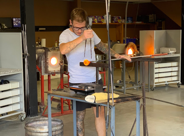 A glass blower making something out of glass at Barleylands Craft Village