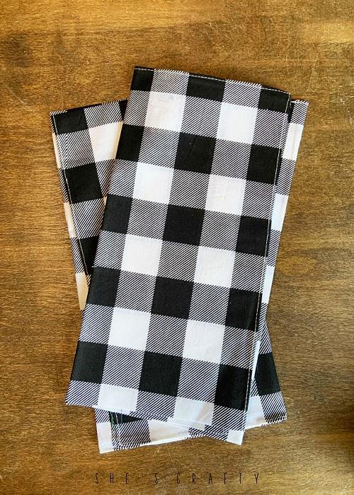 Buffalo check bandannas used to make pillow covers.