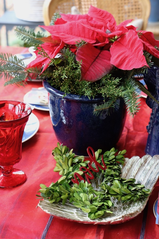 Gold angel wing plate repeats the gold rims of the china on the Christmas Red and Navy Blue Table Setting