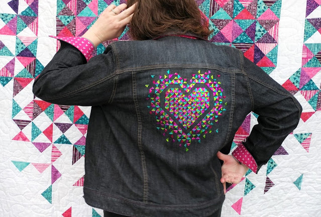 An upcycled denim jacket with hot-fix crystals following the Exploding Heart quilt pattern
